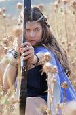 Fairytale girl with bow and arrow — Stock Photo