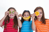 Kids with healthy diet of fruit. — Stock Photo