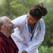 Doctor caring for patient — Stock Photo