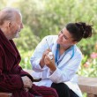 Dr or nurse giving medication to senior patient. — Stock Photo
