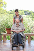 Senior being pushed in wheelchair — Stock Photo
