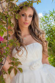 Beautiful blonde in prom dress or wedding gown — Stock Photo
