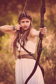 Woodland hunter woman with bow and arrow — Stock Photo