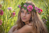 Natural beauty and health, woman with flowers in hair.  — Stock Photo