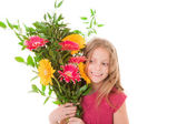 Happy child with boquet of flowers for mother's day — Stock Photo