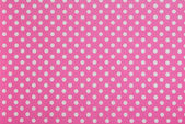 A kropki na różowym tle — Zdjęcie stockowe