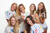 Group of teenagers having fun with paint — Stock Photo