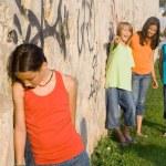 School bully or bullies bullying sad lonely child — Stock Photo #6469827
