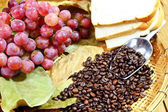 Grapes with coffee beans — Stock Photo