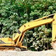 Excavator on a mound — Stock Photo
