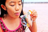 Young girl blowing — Stock Photo