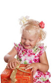 Little girl opening gift box, isolated on white — Stock Photo