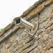 Video camera of system of supervision on a building wall — Stock Photo #12275357