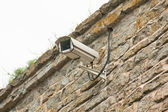 Video camera of system of supervision on a building wall — Stock Photo