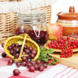 Jam with berries of red currant and gooseberry on the table — Stock Photo