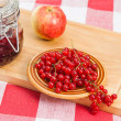Stock Photo: Jam with berries of red currant on table.
