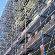 Stock Photo: Scaffolding building under construction