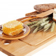 Honey, spike and bread on table  — Stock Photo