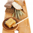 Royalty-Free Stock Photo: Honey, spike and bread on table