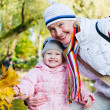 Grandmother with the grand daughter in autumn park — Stock Photo