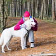 Royalty-Free Stock Photo: The woman with a dog in a forest park