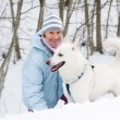 The woman with a dog in winter on walk - Foto de Stock