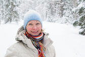 Portrait of a middle-aged woman in winter in the forest — Stock Photo