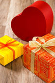 It is red yellow gift boxes, a close up — Stock Photo