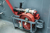 Fire hose on a deck of the ship — Stock Photo