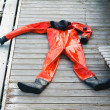 The diving suit lays on a pier — Stock Photo