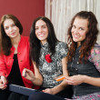 Group beautiful women make purchases on the Internet at home — Stock Photo