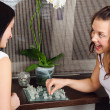 Two young beautiful girlfriends play chess at home — Stock Photo