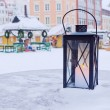 Lantern on table on background of Christmas market — Stock fotografie #18007637
