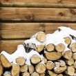 Stock Photo: Birch fire wood at wall of house in winter