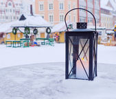 Lantern on a table on a background of the Christmas market — Stock Photo