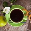 Cup of tea with an apple — Stock Photo