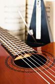 Strings of a guitar and the note — Stock Photo