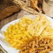 Stock Photo: Variety of pasta, flour and rye cones