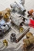 Plumbing Kit on a metal surface — Stock Photo