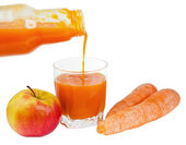 Bottle with carrots juice and an apple — Stock Photo