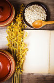 View from the top of an open book of recipes and cooking utensil — Stock Photo