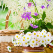 Bouquet of wild flowers in a pot at the table — Stock Photo