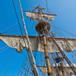 Stock Photo: Mast with sails of old sailing vessel