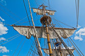 Mast with sails of an old sailing vessel — Stock Photo