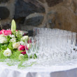 Bouquet of flowers and wine glasses for a wedding table  — Stock Photo