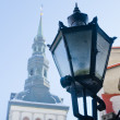 City street lantern on a background of church Niguliste — Stock Photo