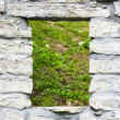 Window aperture in a wall from calcareous stones, a close up — Stock Photo