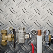 Plumbing inlet pipe valve on a metal surface — Stock Photo #37337839