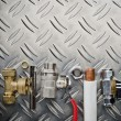 Plumbing inlet pipe valve on a metal surface — Stock Photo