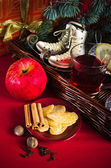 Christmas still life with hot wine and spices — Stock Photo